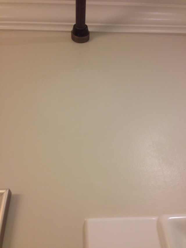 tan bathroom wall painted after drywall repair with oil rubbed bronze shower curtain rod