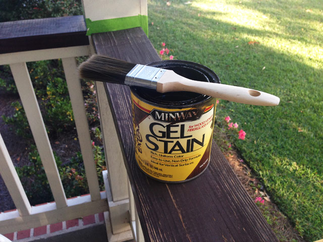 Minwax gel stain in container with paint brush sitting on wood handrails