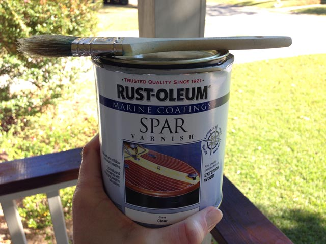 rust-oleum spar varnish being held in hand with paint brush