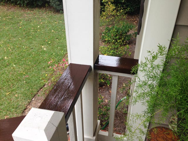 Corner of porch with freshly stained and varnished handrails
