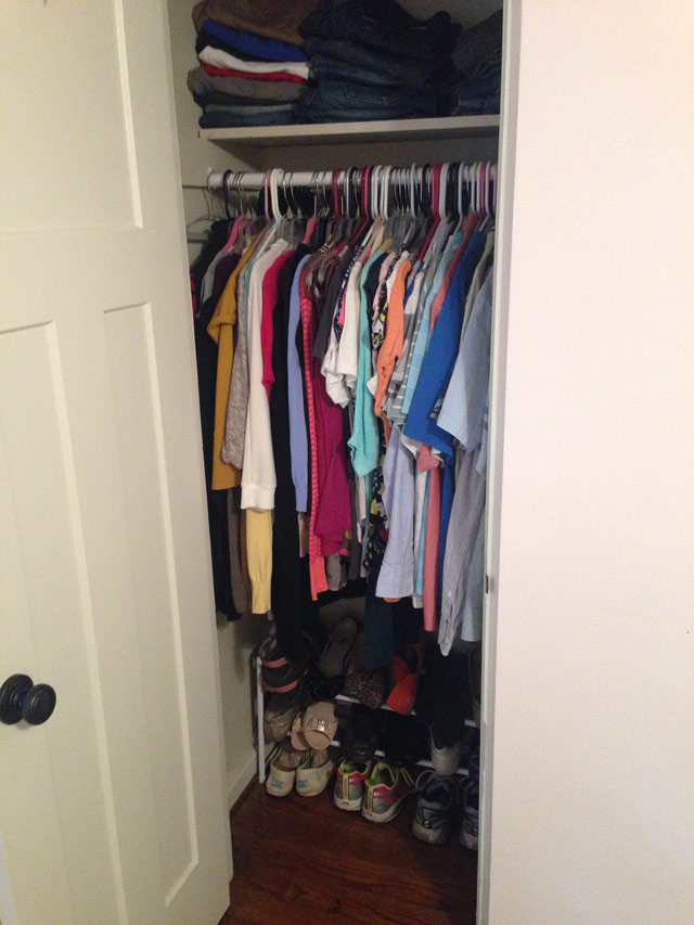 clothes hanging in closet with shoe rack on floor