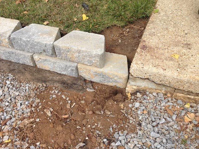 missing block where retaining wall meets sidewalk
