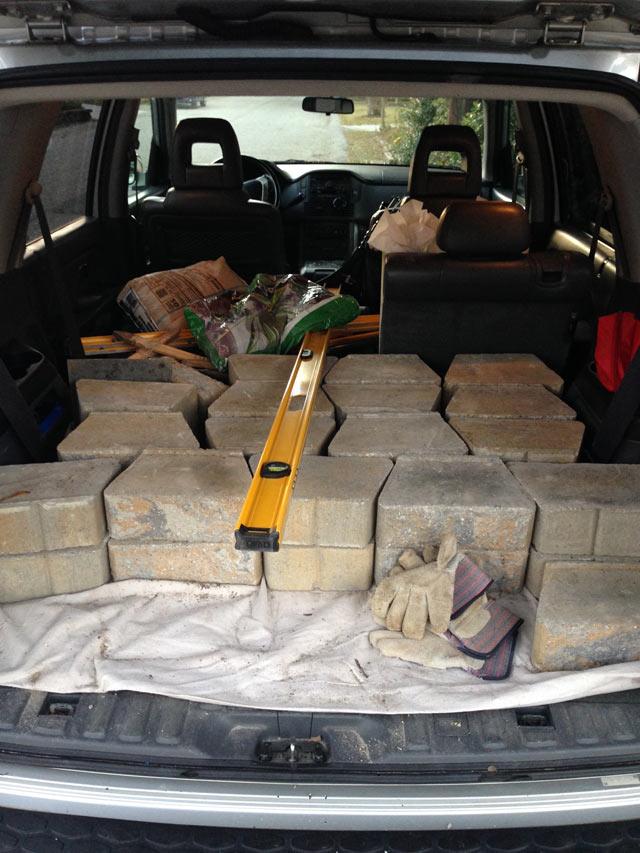 Pavestone retaining wall blocks in back of SUV
