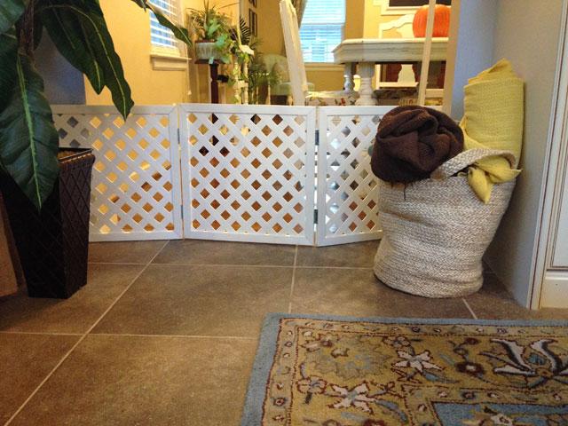 plastic lattice made into pet gate blocking off cased opening