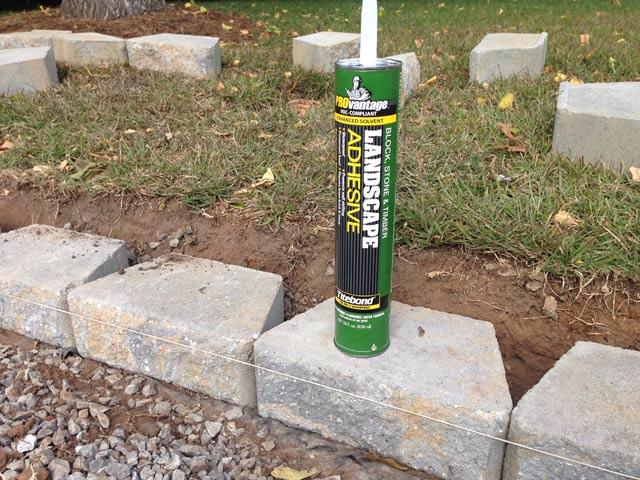 titebond landscape adhesive tube sitting on block retaining wall