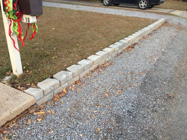 retaining wall complete in front yard with christmas mailbox decoration