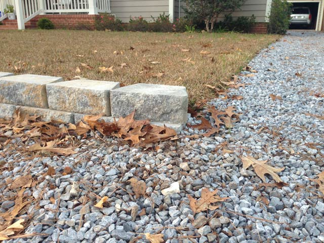 Completed Run Of Retaining Wall Blocks At Gravel Driveway