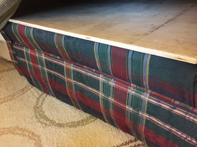 green blue and red plaid ouch with plywood under cushions for support