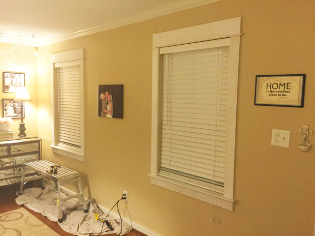 yellow tan walls with fresh installed window trim before painting