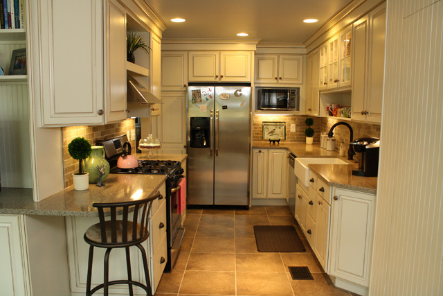 galley kitchen with stainless steel refrigerator