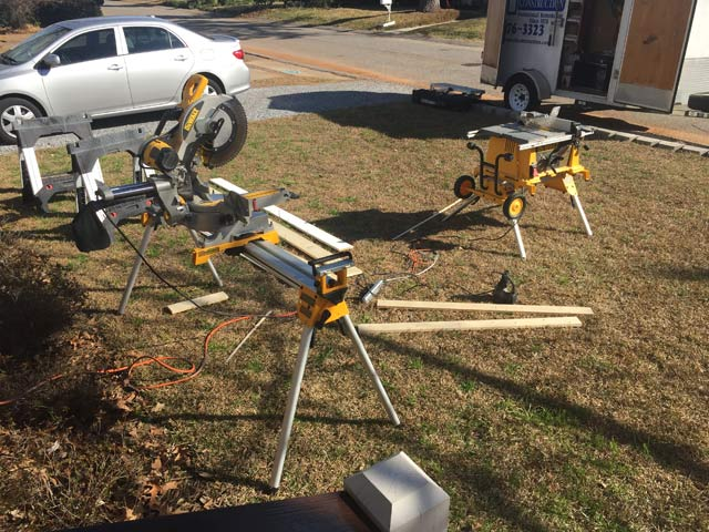 dewalt table saw miter saw in front yard with silver car in background