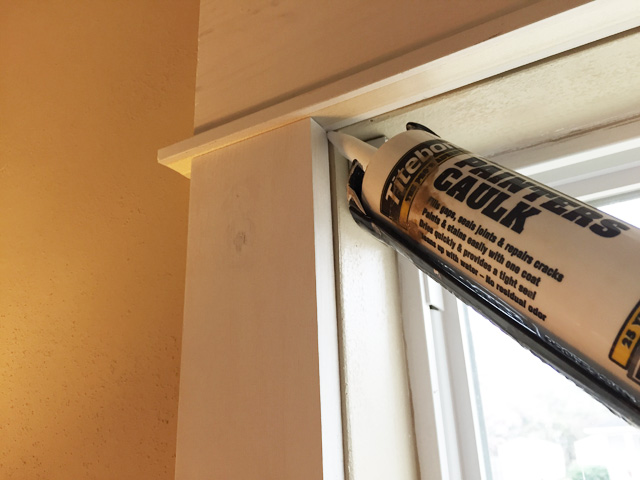 titebond painter's latex caulk tube in caulk gun window trim