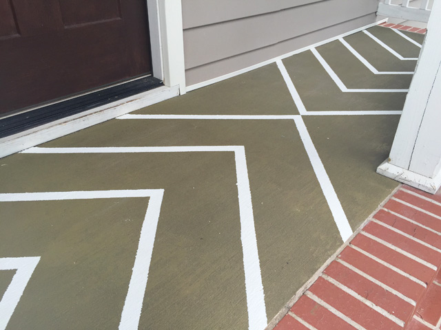 white painted stripes on green concrete porch