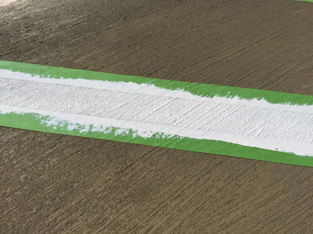 white paint stripe in green painter's tape