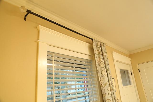 craftsman trim above window and white front door