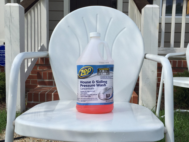House and siding pressure washer cleaning solution soap container sitting on white chair