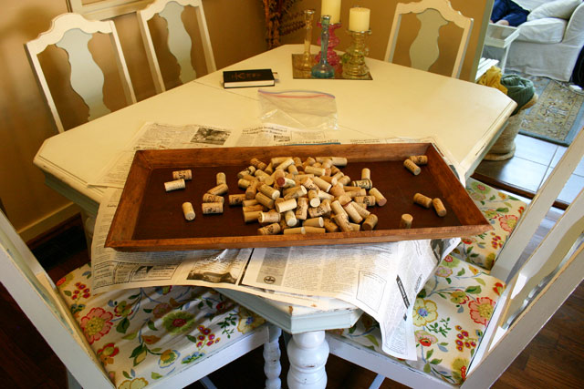 wine corks boot tray shoe tray stained wood on white dining table