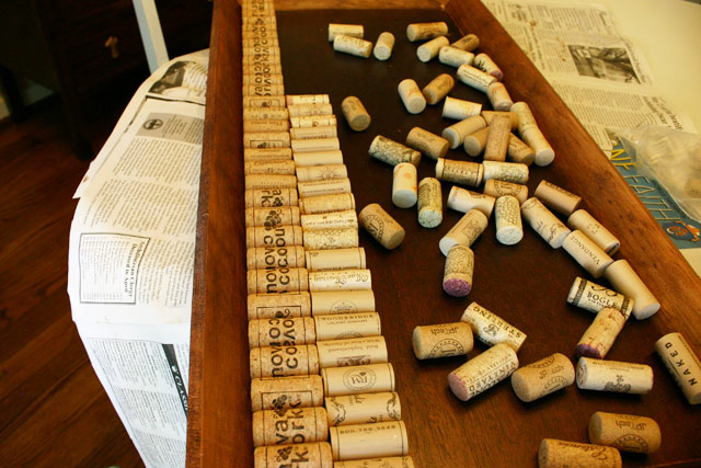 wine corks lined up on shoe tray