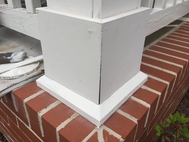white porch column base with crack
