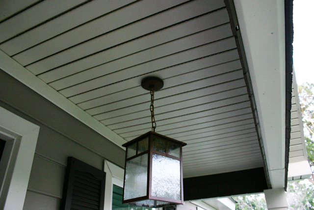 Bronze Pendant Light Hanging From White Vinyl Porch Ceiling