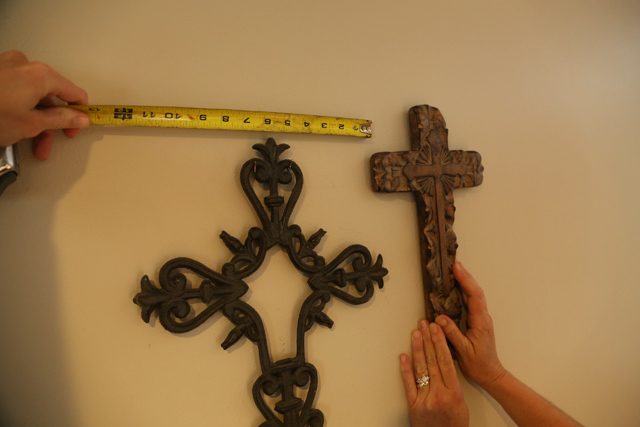 tape measure metal and wood crosses hanging on wall