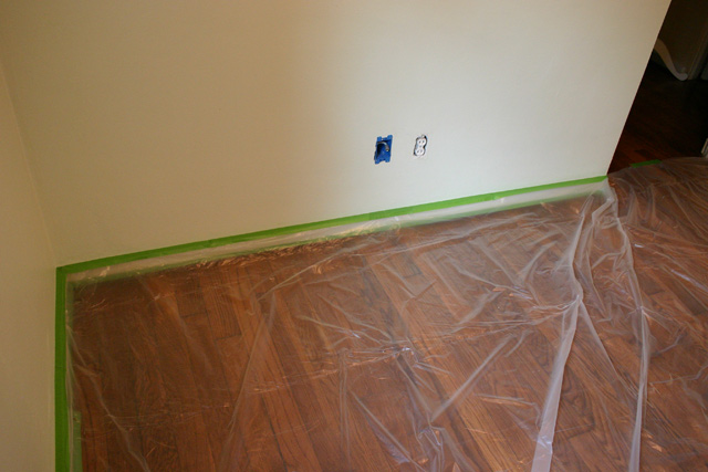 painter's plastic covering stained hardwood floors