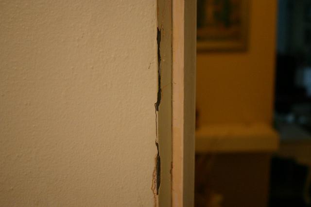 green plaster walls peeling paint metal door strip