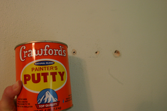 Crawford's painter's putty orange can green plaster wall with holes