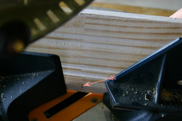 pink arrow showing where to line up saw blade on miter saw