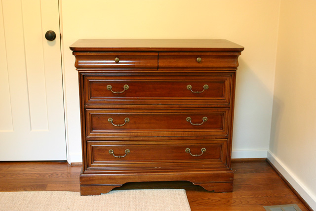 cherry wood stained dresser with brass drawer pull hardware
